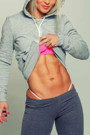 Tanned blonde showing her ABS photo