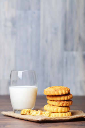 Little cookies and a glass of milk photo