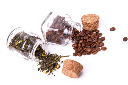 Coffee beans and tea in small jars photo