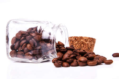 Open jar and coffee beans photo
