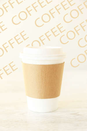 A coffee papercup with a patterned background photo