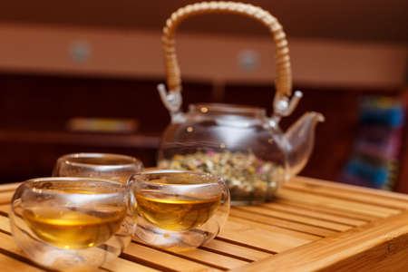 Transparent tea ceremony set on a wooden board photo