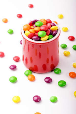 A red jar with colorful hard candies photo