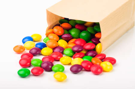 A paper bag with colorful chocolate candies photo