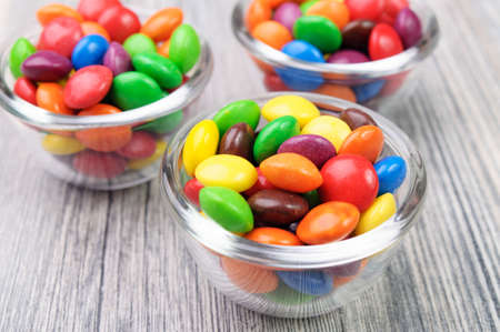 Glass bowls with candies photo