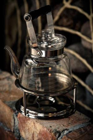 A glass teapot on a gas stove photo