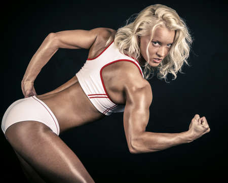 Blonde athlete striking a pose
