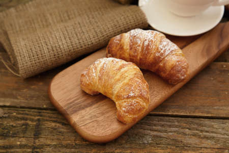 Rustic photo of two croissants on wood photo