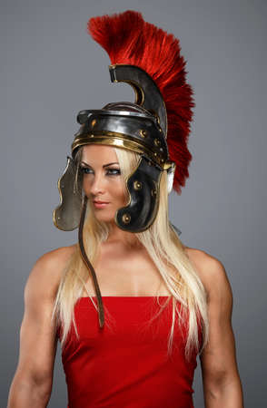 Modern woman wearing an acient centurion headgear photo