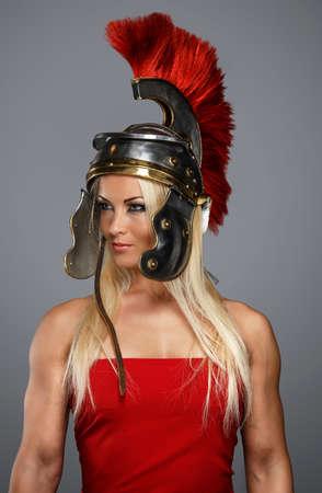 Modern woman wearing an acient centurion headgear