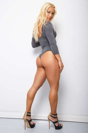muscled: Muscled blonde wearing a grey body-liner