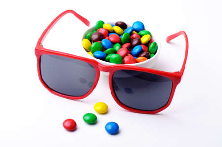 Multicolor candies and red sunglasses photo