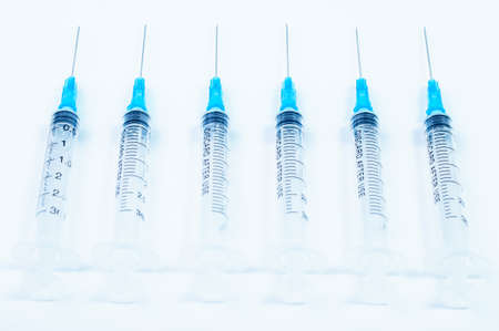 Medical sterile syringes on a white surface photo