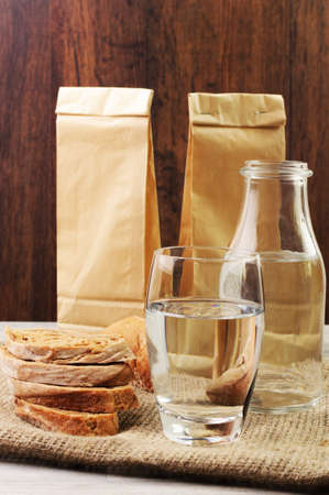 paperbags: Bread and water with paperbags Stock Photo