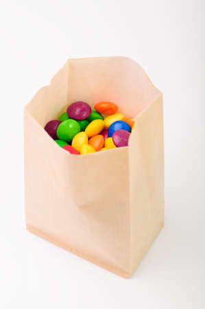 Multi color crunchy candies in a paperbag photo