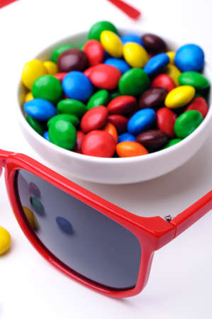 Crunchy colorful confection and red sunglasses photo