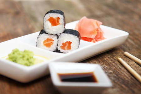 sectioned: A white sectioned plate with sushi, wasabi, and ginger