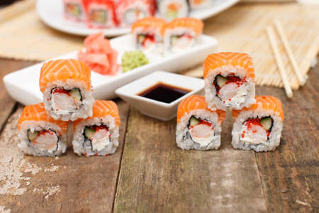 lux: Some lux sushi on a wooden surface