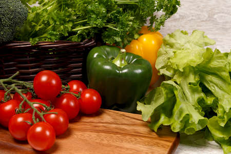 Tomatoes and green vegetables photo