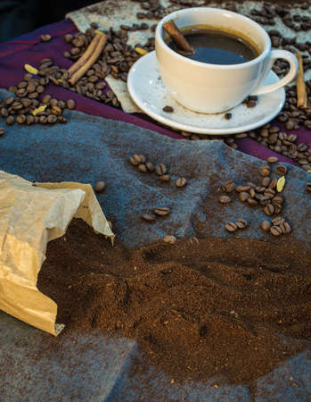 Ground coffee scattered all over the tablecloth photo