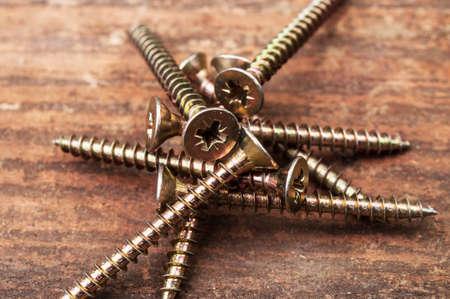 essentially: Some golden screws on wood