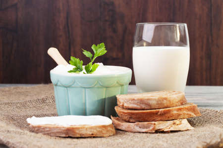 Milk, cream and some sliced bread photo