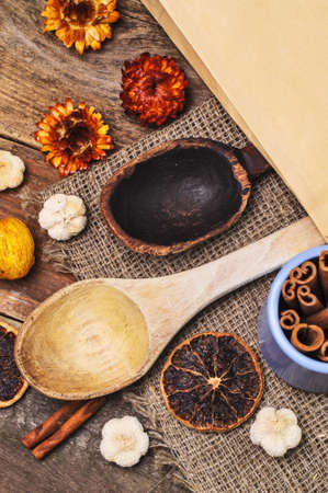 Two wooden spoons with aromatic food ingredients around photo