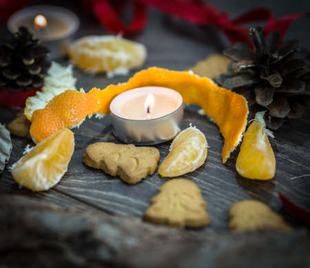 Gingerbread cookies, a candle and mandarines photo