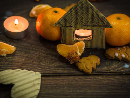 A cardboard house and some mandarines photo