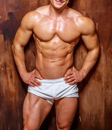 abdominal wall: Fitness. Handsome man with perfect body.studio shot . Stock Photo