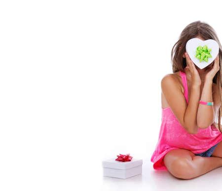 git: Portrait of beautiful girl posing in studio with present