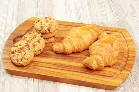 Cutting board with different baked goods
