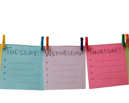 colored paper with days of week and color clothespegs