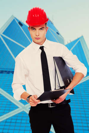 posing  agree: Image of serious guy who is trhinking about information from his papers Stock Photo