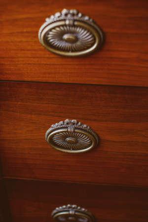 lockers: Image of three lockers on brown cupboard Stock Photo
