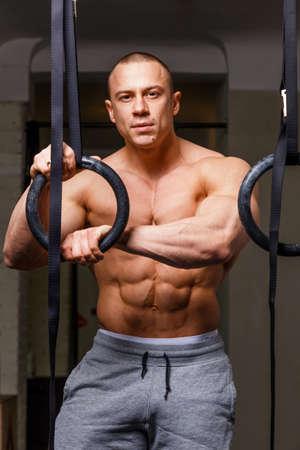 beefcake: Strong muscular man bodybuilder poses Stock Photo