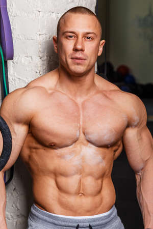 muscular man: Strong muscular man bodybuilder poses and shows his muscles Stock Photo
