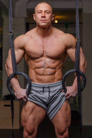 beefcake: Strong muscular man bodybuilder poses and shows his body