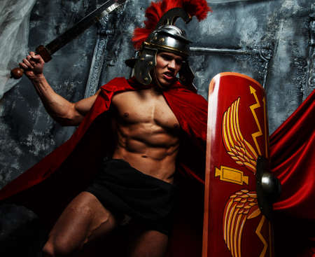 pectorals: Roman warrior with muscular body fights