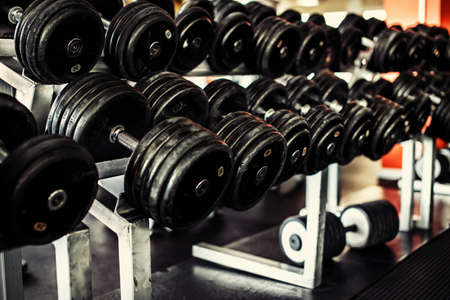 heavy equipment: Image of a heavy iron dumbbells