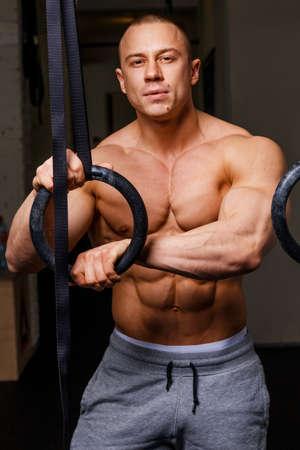 trapezius: Strong muscular man bodybuilder poses Stock Photo