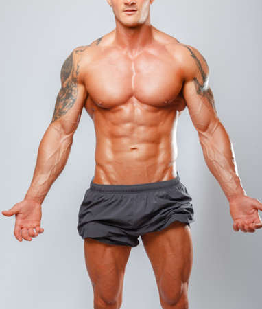 beefcake: Fashion portrait of muscular male showing his body Stock Photo