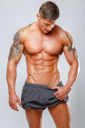 pectorals: Fashion portrait of muscular male showing his body Stock Photo