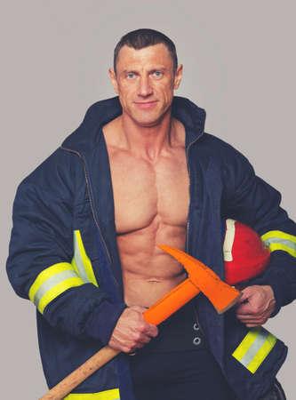Portrait of fireman posing in studio photo
