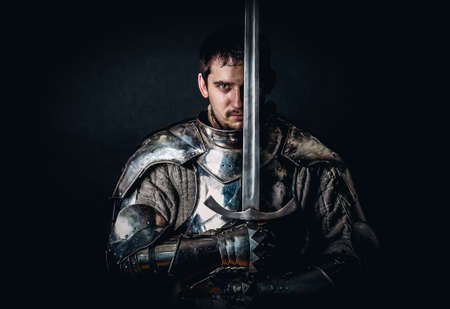 ancient warrior: Glistening Knight holding two-handed sword Stock Photo