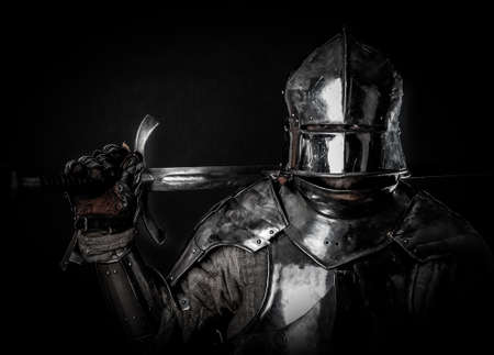 Powerful heavy fighter with sword and helmet Stok Fotoğraf