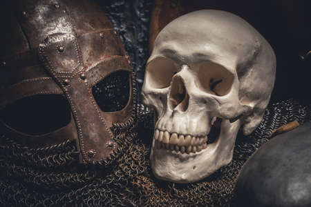 chain armour: Picture of helmet and skull on chain armour