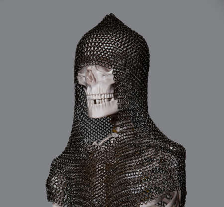 Skeleton of the dead warrior in the helmet and chain armour photo