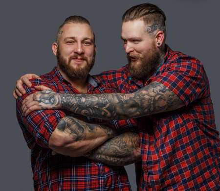 beefcake: Picture of two brutal huge males with beards and tattooes in shirts
