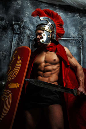 pectorals: Roman muscular shaped warrioir with sword and shield in his hands